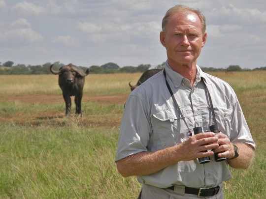 Tony Sinclair in the field studying wildebeest in the Serengeti.