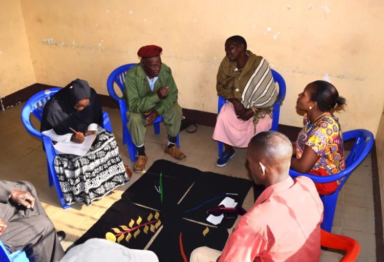 People from all walks of the community discussing a plan for developing a support network for preventing rabies in children and young people in their village (Mkwatani Village, Kilosa District, southern Tanzania) Image: Tiziana Lembo